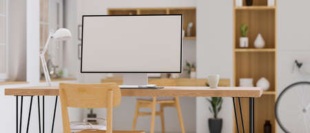 Computer monitor with mock-up screen on wooden table in cozy home office room, 3D rendering, 3D illustration