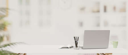 Laptop, stationery and copy space on the table with blur background, 3D rendering, 3D illustration
