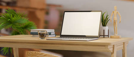 Close-up computer desk with laptop computer blank screen mockup and decor on wooden table over blurred home office background. 3d rendering, 3d illustration