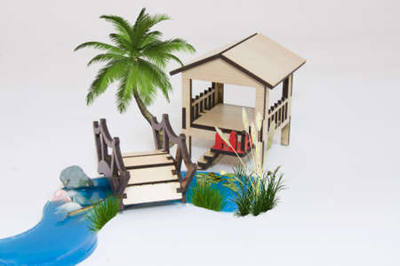 Wooden pergola maquette and small lake with wooden bridge