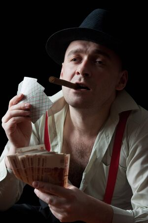 Fine art portrait of man smoking a cigar photo
