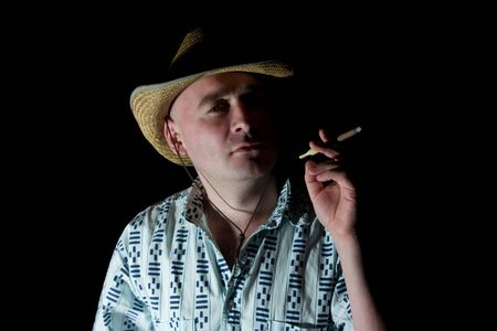 Fine art portrait of man smoking a cigar Stock Photo - 4446000