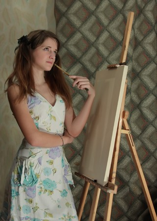 beauty teenager girl  painting on blank white canvas