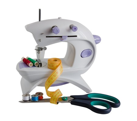 sewing machine with yellow tape-measure. Isolate over white
