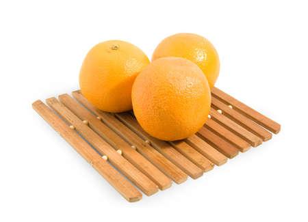 three sweet frash oranges . Isolated over white photo
