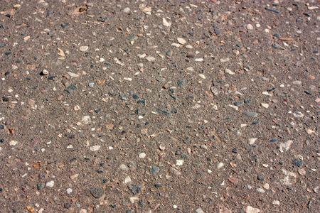 varicoloured: un fondo de carretera asfaltada con piedras multicolores Foto de archivo