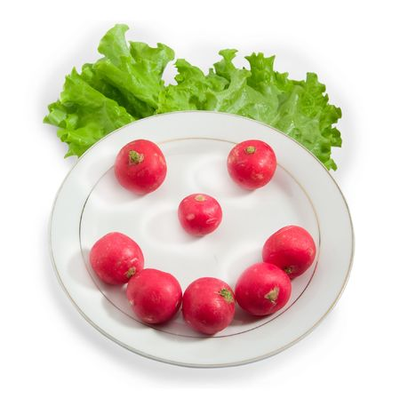 joy smile made of fresh red redish over white dish