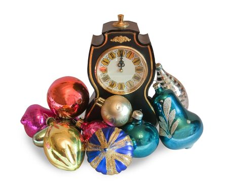newyear night: new-year clock with coloured christmas toys isolated over white Stock Photo