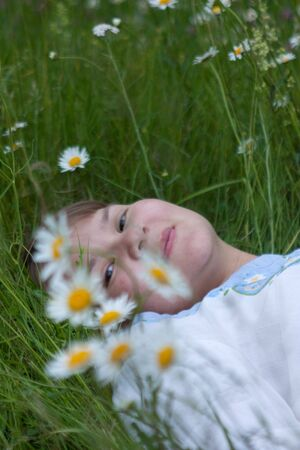 incumbent: pretty girl incumbent over flowering meadow Stock Photo