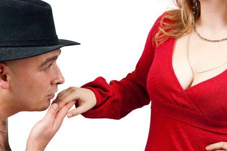 Männer in schwarzen Hut, küssen eine Hand von Mädchen Schönheit. Isolated over white