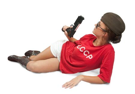 stunningly beautiful young woman posing in garrison cap with gun Stock Photo - 5835505