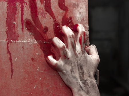 thriller: a bloody hand over background with claret