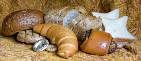 a Loaf of bread over woven linen photo
