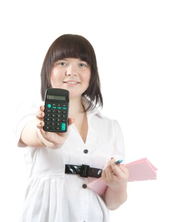 business girl with calculator. Isolated over white. Focus over calculator photo