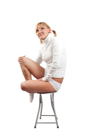 incumbent: Young girl lying on stool. Isolate over wite Stock Photo