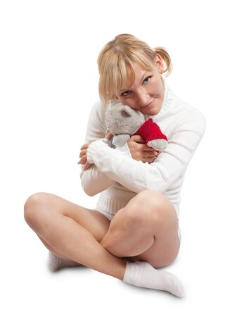Pretty young girl in white with fluffy toy. Isolate over wite