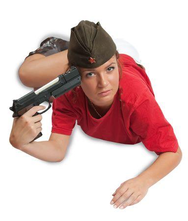 garrison: A stunningly beautiful young woman posing in garrison cap with gun