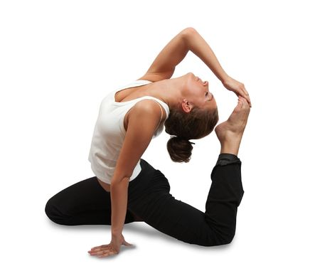 fit brunette in black sportswear practicing yoga over white photo