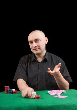 croupier in black shirt  in casino poker at Las Vegas over black