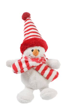 smiling snowman toy dressed in scarf and cap isolated on white background photo