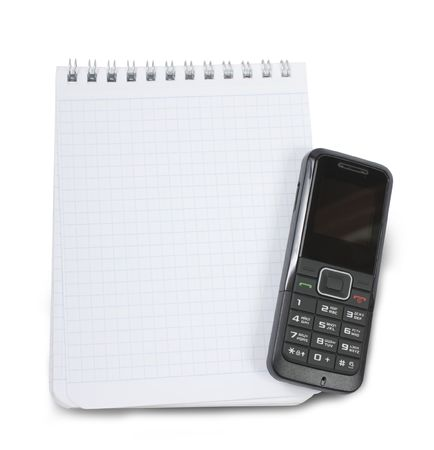 Blank notebook and mobile phone. Isolated on white. Stock Photo - 6298819