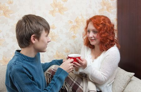 Mother is sicking and her son giving a cup of tea Stock Photo - 6474713