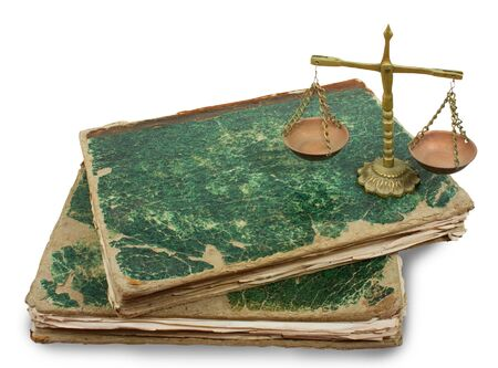 Weighing scales and books isolated over white. Vintage photo