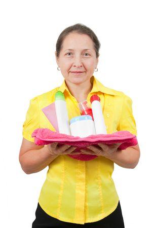 Smiling women senior having hold of toiletries on pink bath towel Stock Photo - 6637355