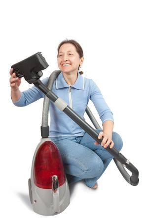 Woman with vacuum cleaner isolated on white photo