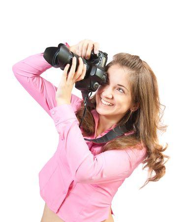 Jong meisje met de camera op wit wordt geïsoleerd