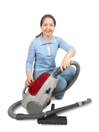Smiling Woman vacuuming - isolated on white background.