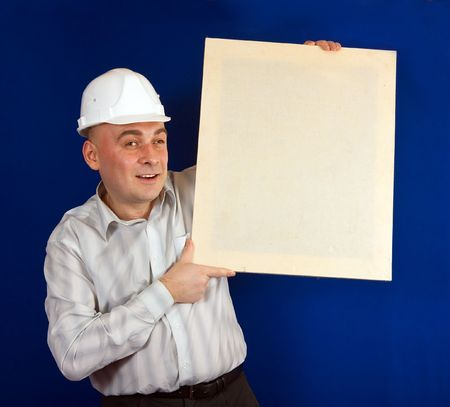 tasker: Adult construction worker in white shirt and hard hat on a blue background