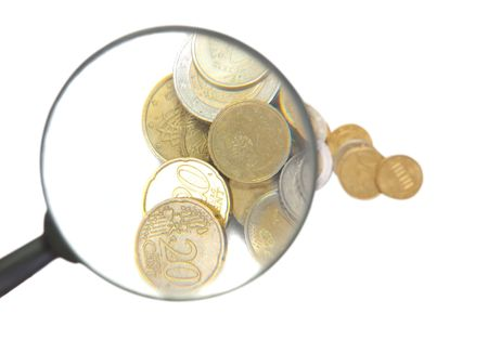 euro coins with  magnifier isolated over white photo