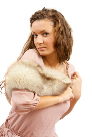 furskin: The posing girl in luxury dress. Isolated over white Stock Photo