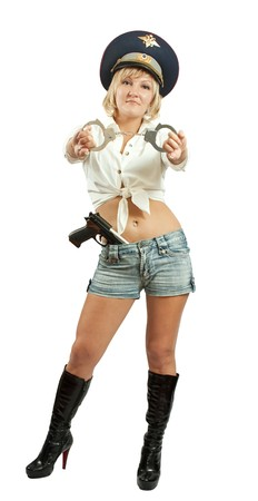 wristlets: Beauty girl with gun and manacles. Isolated over white.   Stock Photo