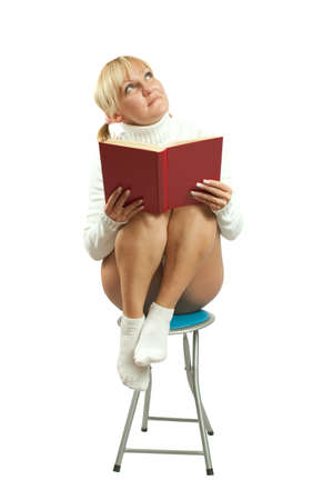 incumbent: Pretty young girl in white reading red book. Isolate over wite