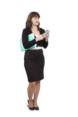 Isolated full length studio shot of businesswoman  writing on her notepad photo