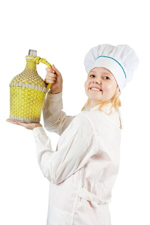 carboy: Portrait of smiling female cook holding large bottle over white   Stock Photo