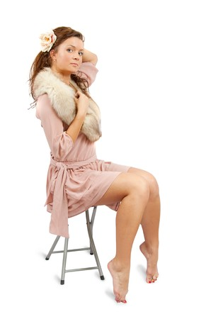 furskin: Fashion type photo of an stunningly beautiful young woman posing on stool