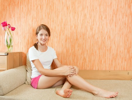 briefs: Nice girl poising on sofa in interior her home