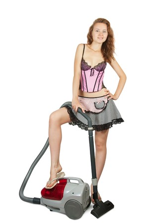 Pretty girl cleans up a vacuum cleaner photo