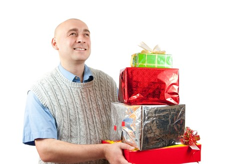 a smiling men holding coloured festive boxis Stock Photo - 7412673
