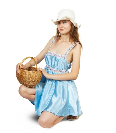 Sexy girl in blue dress with basket . Isolated over white with clipping path Banco de Imagens