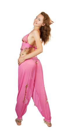 bellydancing: Pretty girl in  pink oriental costume dancing belly-dance