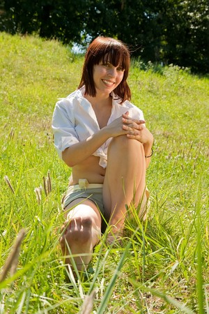 barefoot teen girl is lying at meadow Stock Photo - 7447359