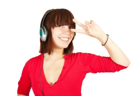 teenager girl listening for the music using headphones photo