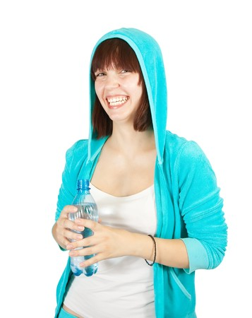 Portrait of smiling sport girl with water bottle over white  background photo