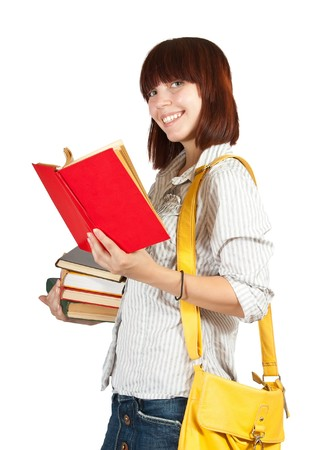Standing schoolgirl reading book, isolated over white Stock Photo - 7466332