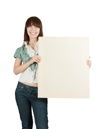 Teen girl holds blank canvas. It is isolated on a white background