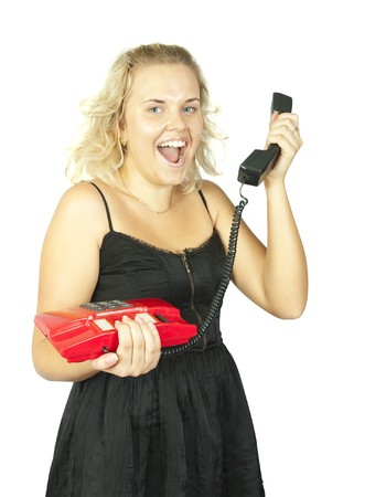 Emotional girl with red telephone Isolated over white  photo